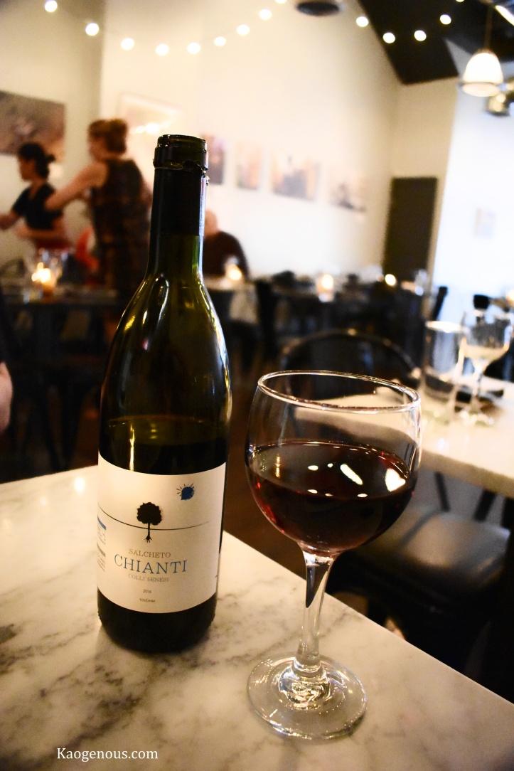 glass and bottle of red wine salcheto chianti pasta dal cuore